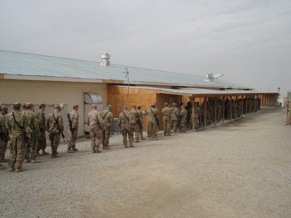 Soldiers waiting in line for lunch.  Used by permission