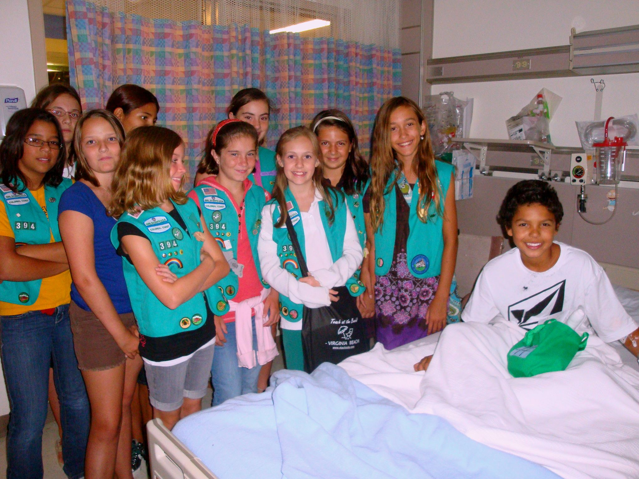 (Troop 394 – Donavan)  Girl Scout Junior Troop 394 from Virginia Beach personally delivered a few of the 46 Comfort and Care bags they put together for children at the Portsmouth Naval Hospital.  During their tour of the pediatric ward, the girls visited several patients, including Donavan, and were able to see first hand the impact their gifts will make on children in the hospital.  