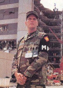 Army Staff Sgt. David Humphries of the 745th Military Police Company, Oklahoma National Guard, stands watch while rescue operations at the Alfred P. Murrah Federal Building continue, April 20, 1995, the day after the Oklahoma City bombing. (U.S. Army Photo by Sgt. Al Newmeyer)
