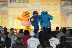 Sesame Street characters perform April 21, 2010, at Bolling Air Force Base, D.C., in an outreach program sponsored by Sesame Workshop and the USO that focuses on talking, listening and connecting for military parents and their children. U.S. Air Force photo by Staff Sgt. Raymond Mills