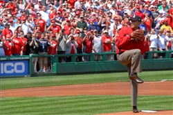 President Barack Obama throws out the ceremonial first pitch to start the baseball season for the Washington Nationals at Nationals Ball Park in Washington D.C., April 5, 2010. The Washington Nationals honored military children, inviting nine children whose parents are deployed to step onto the infield with the starting players to see the president throw out the first pitch. DoD photo by U.S. Navy Petty Officer 2nd Class William Selby