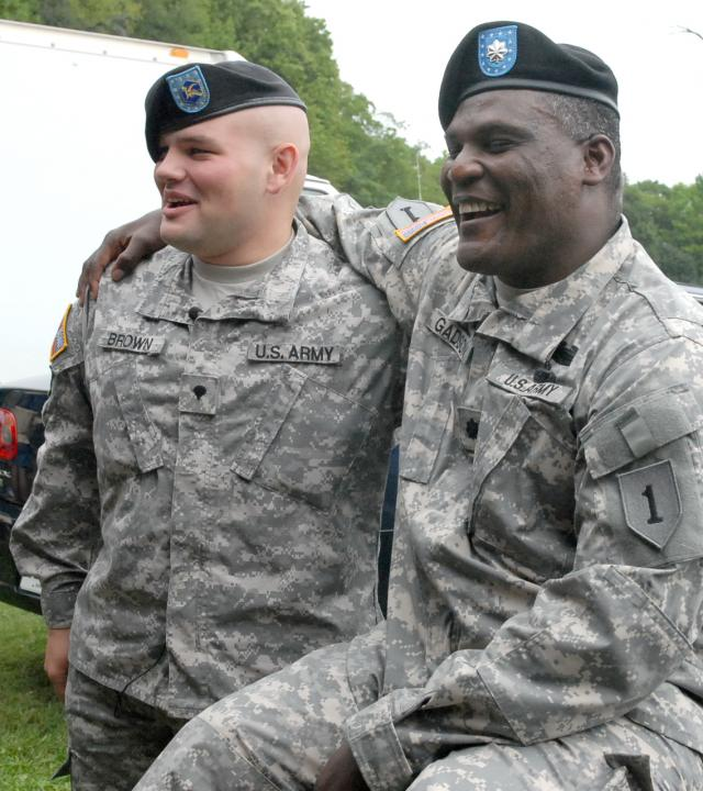 Lt. Col. Gregory Gadson (right) promoted a former battle buddy, Sgt. Eric Brown, to his present rank during the 22nd Chemical Battalion's organizational day activities at Aberdeen Proving Ground, Md. Gadson credited Brown with saving his life after an improvised explosive device destroyed both of his legs in Iraq in 2007. Roger Teel