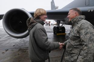 Senior Airman Victoria Drefs, a fuels specialist with the 376th Air Expeditionary Wing, shakes hands with Lt. Gen Gary North, Air Forces Central Commander, as she is about to reach the two-million-gallon mark for fuel delivered during her deployment. The Armour, S.D., native, deployed to Manas for four months from Aviano Air Base, Italy, is the first and likely only Airman to reach two million gallons this rotation. Senior Airman Ruth Holcomb, 376th Air Expeditionary Wing
