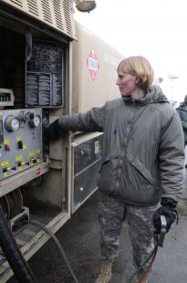 Senior Airman Victoria Drefs, a fuels specialist with the 376th Air Expeditionary Wing, prepares to pump fuel from her R-11 fuel trunk into a KC-135 Stratotanker to surpass the two-million-gallon mark for fuel delivered during her deployment. The Armour, S.D., native, deployed to Manas for four months from Aviano Air Base, Italy, is the first and likely only Airman to reach two million gallons this rotation. Senior Airman Ruth Holcomb, 376th Air Expeditionary Wing