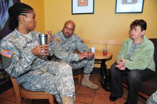 Sgt. 1st Class Pam Ames and Sgt. John Utsey, Soldiers representing the Colorado Army National Guard, speak with Cindy Barnhill at a Starbucks Coffee store in Centennial Colo., Dec. 29. In a personal mission spanning two and a half years, Barnhill, of Parker, Colo., has singlehandedly purchased more than $15,000 worth of coffee for service members and first responders in the two communities south of Denver. Joint Force Headquarters – Colorado National Guard Public Affairs