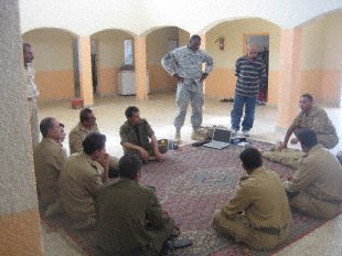 Sgt. 1st Class Christopher E. Brown, a medical advisor from Temple, Texas, supervises Shurta (police officers) providing first aid instruction at Zubaidat (1st Company) Border Fort.