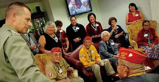 Marine Gen. Peter Pace, former chairman of the Joint Chiefs of Staff, left, meets with five Navajo code talkers and their family members at the Pentagon, Aug. 10, 2007. All five served as U.S. Marines in World War II and helped develop a communications code based on their native language.