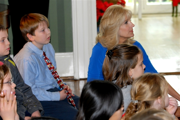 "Dr. Jill Biden, wife of Vice President Joe Biden, joins children for a reading of ""Mickey's Christmas Carol"" by Army Maj. James Blain, who is deployed in Afghanistan, at the U.S. Naval Observatory in Washington, D.C., Dec. 12, 2011. Blain's son, Jimmy, was among the children at the party. DOD photo by Elaine Sanchez"