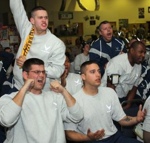 Airmen deployed here cheer and jeer while watching Super Bowl XLIII, at the Housing 6 Red Tail Recreation Center early morning, Feb. 2. , Tech. Sgt. Lionel Castellano