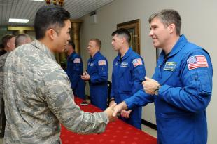U.S. Air Force Capt. Jimmy Do, from Anaheim, Calif., meets Navy Capt. Stephen G. Bowden, NASA astronaut, at Camp As Sayliyah, Qatar, Feb. 2.