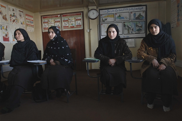 A group of midwives-in-training sit in their classroom at a training facility on the Gardez provincial hospital campus in Gardez City, Afghanistan, Feb. 17, 2009. Midwives are a staple in the delivery of health care across the rural Paktia province. DoD photo by Fred W. Baker III