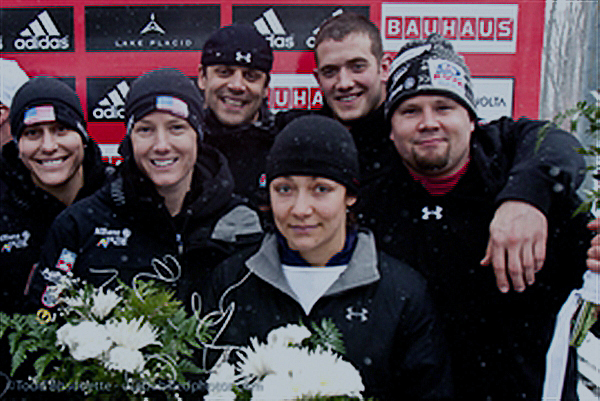 Army Spc. Shauna Rohbock of the Utah National Guard, second from left, stands with the U.S. bobsled team at the bobsled world championships at the Olympic Sports Complex in Lake Placid, N.Y., Feb 22, 2009. Rohbock and her teammate won a silver medal in the women's division. Courtesy photo by Todd Bissonette