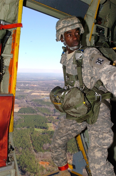 Army Sgt. 1st Class Larry Carter, a jump master with the Army Reserve�s 421st Quartermaster Company, 143rd Sustainment Command, prepares to jump out of an Air Force C-130 during an Employer Support of the Guard and Reserve �Boss-lift� event Jan. 9, 2009, in Fort Valley, Ga. U.S. Army photo by Spc. Ian Morales