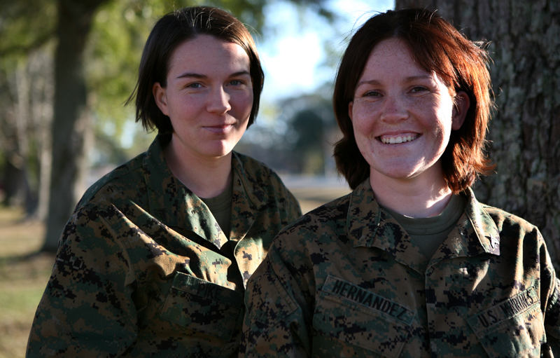 MARINE CORPS BASE CAMP LEJEUNE, N.C. (Dec. 30, 2008)-Cpl Kimberly Pike (left), an administrative clerk with the 2nd Marine Logistics Group Administrative Section, and Cpl. Kendra Hernandez, a legal clerk with Headquarters and Service Company, Combat Logistics Regiment 27, 2nd MLG, stand together, here, Dec. 30. The two Marines donated more than 26 inches of their hair to Locks of Love., Cpl. Aaron Rooks, 12/30/2008 6:02 PM