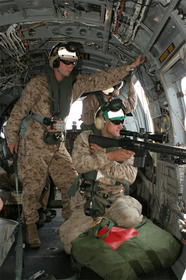 GULF OF ADEN (Sept. 27, 2008) -- A scout sniper from Battalion Landing Team 2/6, 26th Marine Expeditionary Unit,  fires his MK-11 sniper rifle from a CH-46 Sea Knight helicopter, Sept. 27, 2009, while flying over the Gulf of Aden.  The snipers practiced firing at floating targets from different places inside the helicopter during the training.  The 26th MEU and Iwo Jima Strike Group are currently deployed in the Central Command area of responsibility. (Official USMC photo by Cpl. Aaron J. Rock