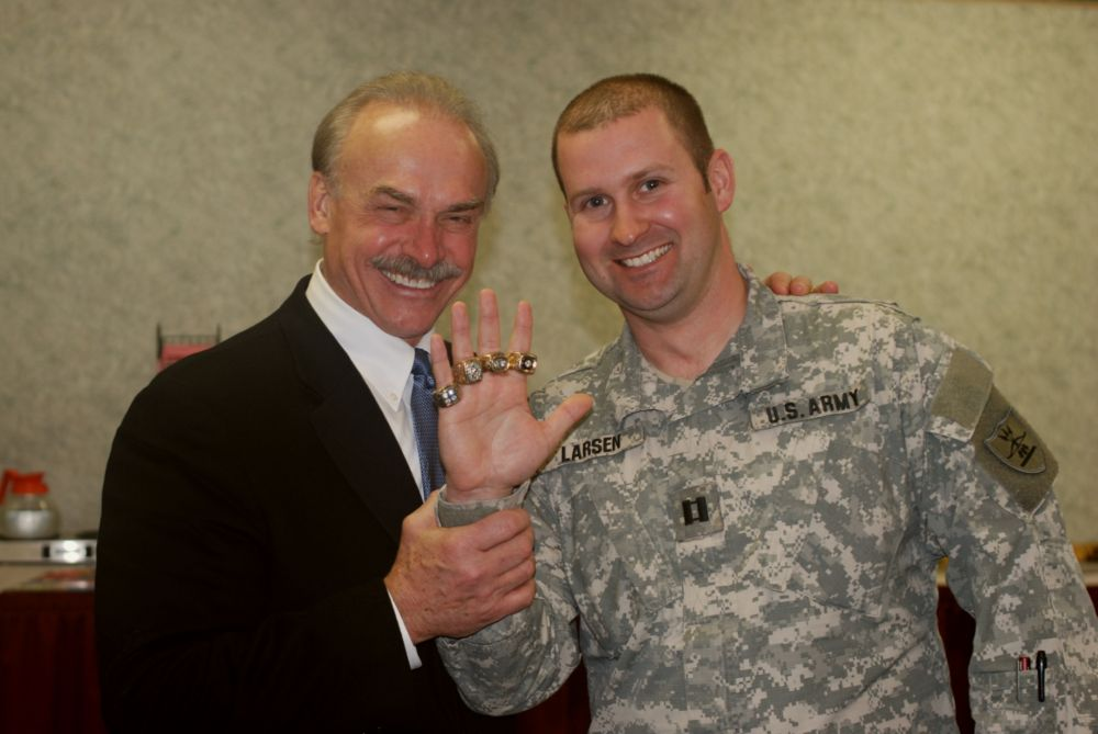 Vietnam Veteran and former Pittsburgh Steeler Rocky Bleier poses with Capt. Doug Larsen and Bleier's four Superbowl rings at the N.D. National Guard's 2009 Safety Conference in Bismarck on Jan 24. Bleier was the keynote speaker for the conference. Bill Prokopyk, N.D. National Guard