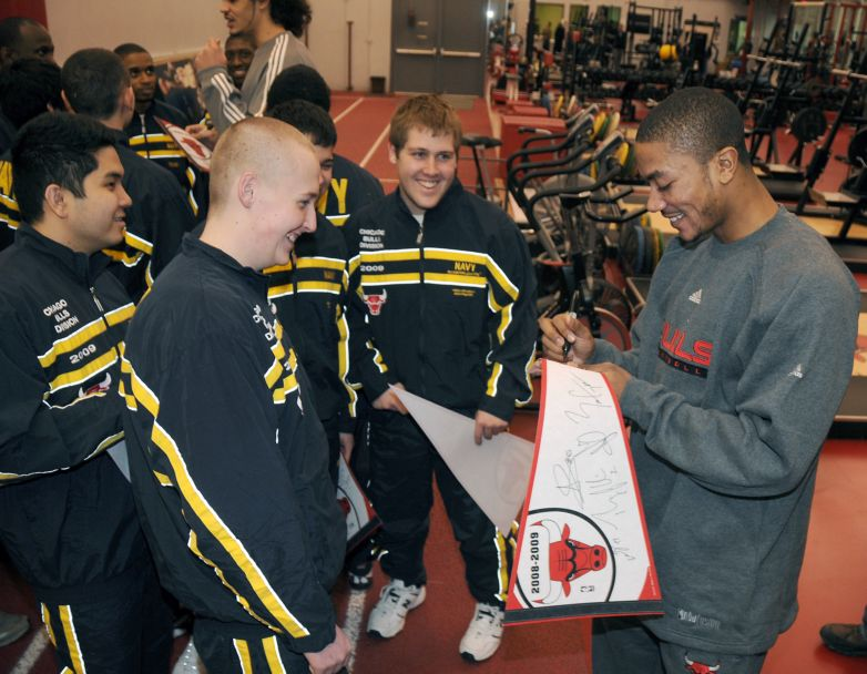 Chicago Bulls guard Derrick Rose signs autographs for a group of Chicago-area recruits at the Chicago Bulls Berto Center practice facility. The 30 recruits were part of an enlistment swearing-in ceremony at the center marking a new partnership between Recruit Training Command and the Chicago Bulls. The Chicago Bulls division will train for eight weeks at Recruit Training Command at Naval Station Great Lakes, Ill., the Navy's only boot camp, before joining Navy schools and commands around the world. U.S. Navy photo by Scott A. Thornbloom