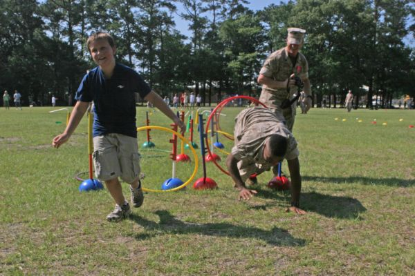 CAPE CARTERET, NC (June 2, 2009) – Carson Brinkley, a fourth-grader at White Oaks Elementary, beats Cpl. Henry McNeil of 2nd Battalion, 6th Marine Regiment, 2nd Marine Division at the last hurdle of the obstacle course at a field meet, 2 June 2009. Marines of 2/6 volunteered at the event. (Official USMC photo by Cpl. Jesse J. Johnson)
