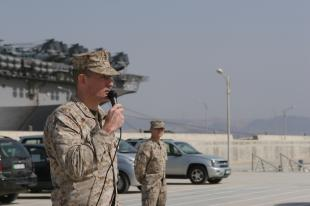 Col. David W. Coffman, commanding officer of the 13th Marine Expeditionary Unit, addresses a formation of Marines during a ceremony to award the global war on terrorism Expeditionary Medal to eligible Marines pier side in the Middle East, representing the entire MEU who is spread across the Middle Eastern region. The one-time award is given to those service members who served in a pre-designated specific geographical area, by the Department of Defense, for 30 consecutive or 60 nonconsecutive days in support of global war on terrorism operations on or after September 11, 2001. The 13th MEU and Boxer Amphibious Ready Group are currently on a deployment in support of regional and Maritime Security Operations. Cpl. Robert C. Medina
