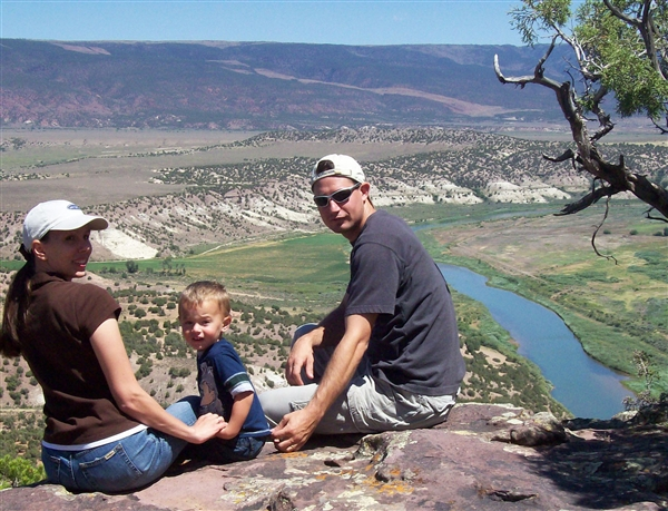 Air Force Senior Airman Eric Slaugh, his wife, Marcie, and his son, Skyler, enjoy the view of the Green River in Wyoming during a family vacation. Slaugh, assigned to the 27th Special Operations Component Maintenance Squadron at Cannon Air Force Base, N.M., used his self-aid and buddy care training to assist a man hit by a train in December 2008. Courtesy photo
