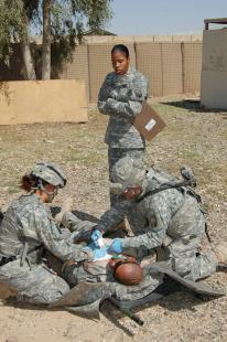 Sgt. Evelyn Pollard, medical treatment non-commissioned officer in charge, 16th Special Troops Battalion, 16th Sustainment Brigade, evaluates Soldiers going through the Combat Life Saver Course at Contingency Operating Base Q-West, April 9. Sgt. 1st Class Adam Shaw