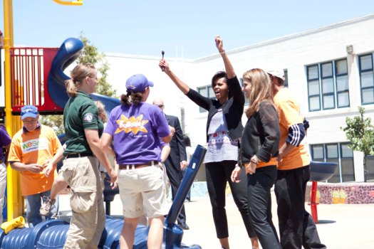 (First Lady Michelle Obama promotes the White House's United We Serve volunteering initiative at the Bret Harte Elementary School in San Francisco, California with Maria Shriver, First Lady of California, June 22, 2003. Official White House Photo by Samantha Appleton)