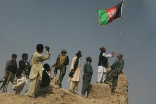 The Afghan national flag was raised above Khan Neshin castle in the Rig District Center, July 8, for the first time, signaling the arrival of Afghan governance in the southern reaches of Helmand province. Cpl. Aaron Rooks