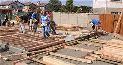 MARINE CORPS BASE CAMP PENDLETON, Calif.-Volunteers from Habitat for Humanity of Orange County help during construction of one the houses at Calle Roland in San Juan Capistrano, Calif, July 10. Fourteen of the homes in this neighborhood will be marketed to combat-disabled veterans and their families., Sgt. Alvaro Aro, 7/10/2009 5:40 AM