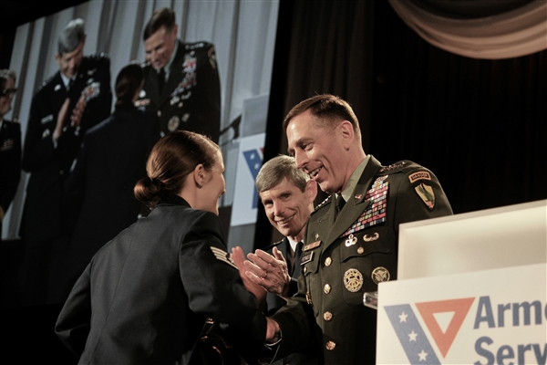 U.S. Air Force Staff Sgt. Stephanie Cates receives the Angels of the Battlefield Award from U.S. Army Gen. David Petraeus, commander, U.S. Central Command, and U.S. Air Force Chief of Staff Gen. Norton A. Schwartz, during a dinner in honor of military medics and corpsman at the Ronald Reagan Building in Washington, D.C., March 11, 2009. U.S. Air Force photo by Tech. Sgt. Suzanne M. Day