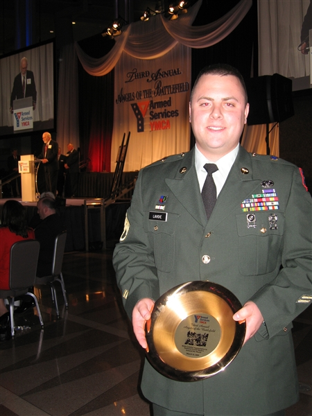 Army Staff Sgt. Matthew, a decorated army medic who served a tour in Iraq with the Rhode Island Army National Guard, poses with an award he accepted at the 3rd annual Armed Services YMCA 'Angels of Battlefield' gala in Washington, D.C., on March 11, 2009. DoD photo by John Kruzel