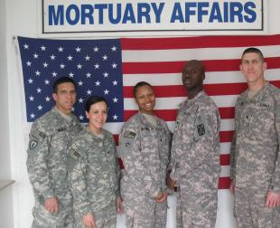 Spc. Jesus Munoz Aviles, from Arecibo, P.R.; Spc. Kimberly Gallegos, from Pueblo, Colo.; Spc. Britney Brooks, from Virginia Beach, Va.; Spc. Kenneth McWilliams, from Philadelphia, Miss.; and Staff Sgt. John Stittgen Jr., from Frederick, Md.; all members of the Mortuary Affairs Collection Point team, 111th Quartermaster Company, 18th Combat Sustainment Support Battalion, 16th Sustainment Brigade, at Contingency Operating Site Marez-East, Iraq, recover, process, and ship the remains of U.S. service members, Department of Defense contractors, coalition forces and Iraqi security forces who lose their lives while supporting Operation Iraqi Freedom. The team arrived at Marez-East in November of 2008, and is five months into a six-month deployment due to the psychological stress that is an occupational byproduct of the performance of their mortuary affairs duties in a combat zone. Photo by Sgt. Jerome Gisclair
