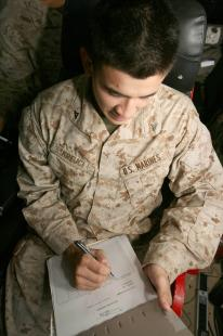 Lance Cpl. Joshua A. Krejci, a rifleman with Company C, Battalion Landing Team 1/1, 13th Marine Expeditionary Unit and member of Combat Cargo, from O'Fallon, Mo., creates a manifest for service members getting ready to debark USS Boxer. The 13th Marine Expeditionary Unit and Boxer Amphibious Ready Group are currently on a deployment in support of regional and Maritime Security Operations. Megan E. Sindelar