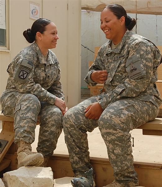 Army Staff Sgt. Melodie A. Hunt, left, and her sister, Army Pfc. Mallorie A. Hunt share a moment during their lunch time. The Hunt sisters are deployed to Baghdad. U.S. Army photo by Pfc. Jasmine N. Walthall