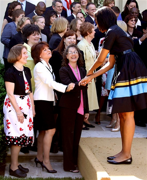 Michelle Obama shakes hands with one of 55 Teachers of the Year in the White House Rose Garden at the ceremony announcing the National Teacher of the Year on April 28, 2009. Dorothy Goff Goulet, Department of Defense Education Activity's 2009 Teacher of the Year, second row on right, awaits her turn to shake hands with the first lady. Photo courtesy of Darren Santos