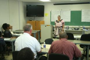 Joan Fanger, a receptionist at the Public Works Office on the Air Station, speaks to a class about square dancing March 25 in the education building aboard Fightertown. Fanger lost 174 pounds because of square dancing. Lance Cpl. Kelvin Clark