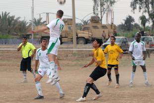 1st Lt. Paul Wistermayer, from Denville, N.J., the assistant intelligence officer for Headquarters and Headquarters Company, 1st Battalion, 505th Parachute Infantry Regiment, takes a header in the opening round of the Combined Forces Football Tournament, a Baghdad-wide tourney featuring teams made up of American and Iraqi players. Wistermayer's team ultimately lost the game 3-2. Sgt. Joshua Risner
