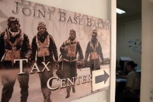 A sign points visitors to the Joint Base Balad Volunteer Tax Center at Joint Base Balad, Iraq, April 30. Over a period of three months, 1,300 tax returns were filed out of this office. Spc. Kiyoshi Freeman