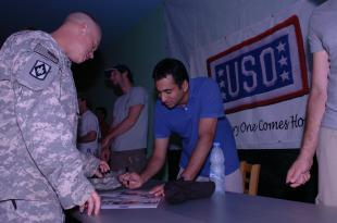 Specialist Charles Davis receives and autograph from filmstar Kal Penn at the recreation center Friday evening. Celebrities from the Hollywood Handshake Tour visited Camp Lemonier May 15-16 to show their appreciation and personally thank service members for their sacrifices. Petty Officer 2nd Class Kelly Ontiveros