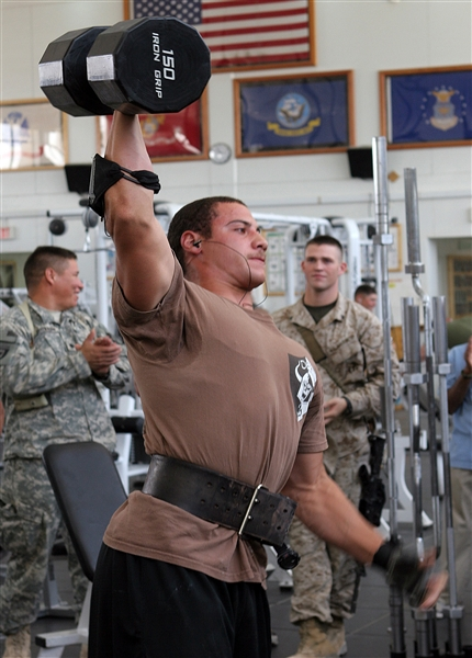 Navy Seaman Chris Spencer lifts a 150-pound dumbbell over his head during the Strongest Man competition at Hero's Hall gym aboard Al Asad Air Base, Iraq, May 16, 2009. Spencer won all six challenges in the competition and was named Al Asad's Strongest Man. U.S. Marine Corps photo by Cpl. Triah Pendracki