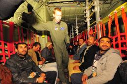 A U.S. airmen stands among displaced Egyptian citizens aboard a U.S. Air Force C-130J that is transporting them to Cairo, Egypt. They boarded the aircraft in Djerba, Tunisia, after fleeing the recent violence and political instability in Libya. This reponse to the developing humnaitarian crisis is part of a broader U.S. government effort to relieve suffering caused by the crisis in Libya. (U.S. Army photo by Staff Sgt. Brendan Stephens)