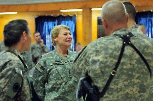 Gen. Ann Dunwoody, commanding general of Army Materiel Command and the first female to earn four stars in the U.S. military, is greeted upon arriving at the 1st Armored Division Chapel to attend the U.S. Division-Center Women\'s History Month observance March 20.