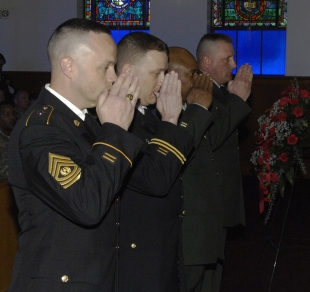 Army Reserve NCO Academy leadership salute as they render final honors at the close of the memorial service for Sgt. 1st Class Mary Russell held at Army Support Activity-Dix's Main Chapel, May 4. Russell died as the result of injuries sustained during a motor vehicle accident, April 20. Positioned left to right are NCO Acedemy Commandant Command Sgt. Maj. Peter Brooks of North Hampton, Mass., ASA-Dix Main Chapel staff chaplain, Maj. Bill Heisterman of Clifton, N.J., deputy commandant Sgt. Maj. McClinton Brown of Chicago, and 1st Sgt. Roy Waters of Wauconda, Ill.