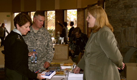 General Mari K. Eder,  escorted by Lt. Col. Bob White visited Military Family Network and talked with Megan Turak Executive Vice President about their Military Family Resource book
