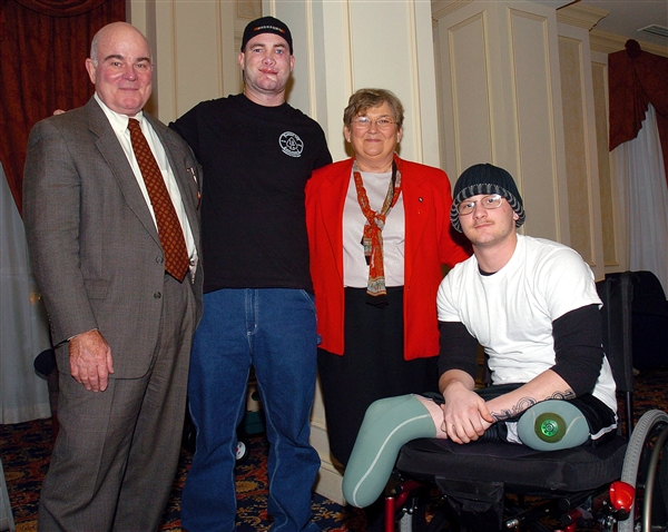 Then-Army Secretary Francis J. Harvey, left, and his wife, Mary, meet with Army Sgt. Robert Bartlett, center, and Army Cpl. Todd Bishop. The soldiers were recovering at Walter Reed Army Medical Hospital in Washington. Both were injured by a roadside bomb near Baghdad on May 3, 2005. U.S. Army photo by Staff Sgt. Carmen L. Burgess