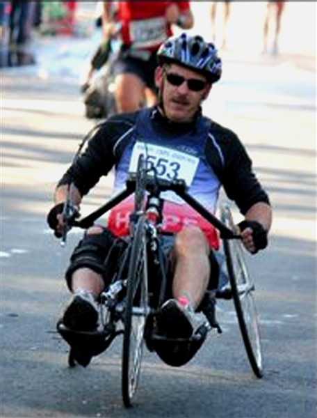 Marine Chief Warrant Officer 4 Chris Hedgcorth participates in the 33rd Marine Corps Marathon in Washington, D.C., Oct. 26, 2008. He completed the 26.2 miles on a hand cycle as part of a fundraising effort for other wounded servicemembers. Courtesy photo by Nicole Benitez