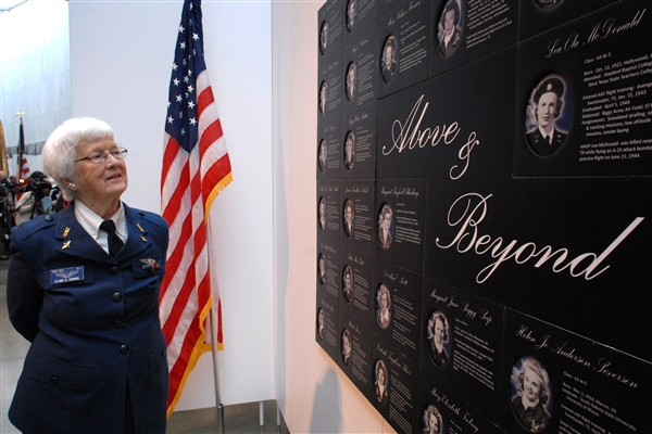 Elaine D. Harmon, a former pilot of the Women Airforce Service Pilots program, walks through the