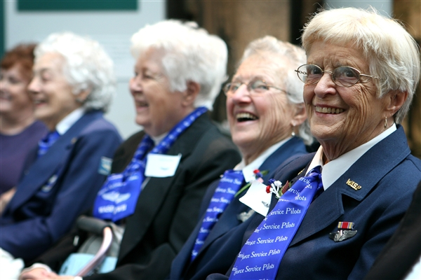 Former pilots of the Women Airforce Service Pilots program share a laugh during the grand opening of the