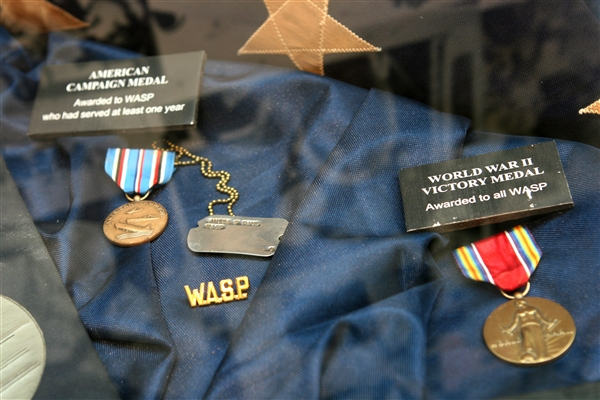 American and World War II campaign medals are displayed in a glass case as part of the