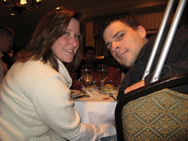 """Army Staff Sgt. Anthony Maschek, right, and his wife, Angela, enjoy a wounded warrior dinner held at the Capitol Hill Club Nov. 14, 2008. Maschek, a 10th Mountain Division infantryman from Twin Falls , Idaho, was shot 11 times causing two broken legs during a February 2008 firefight near Kirkuk in northern Iraq . """"It's really nice,"""" Maschek said of the dinners and other events conducted for wounded troops. """"So many people come in and talk to us and do things for us."""" DoD photo by Gerry J. Gilmore"""