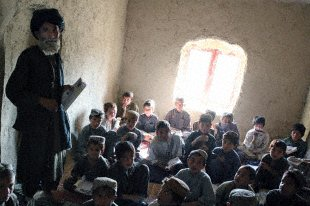 A village elder ensures discipline in the pronunciation of the Pashtu alphabet at the Khan Neshin School in the Rig District, Nov. 2, 2009. The school currently facilitates 120 students grades one through three. Cpl. Jennifer Calaway
